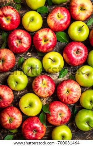 Fresh organic red and green apples with leaves on wooden background in wooden box Stock photo © DenisMArt