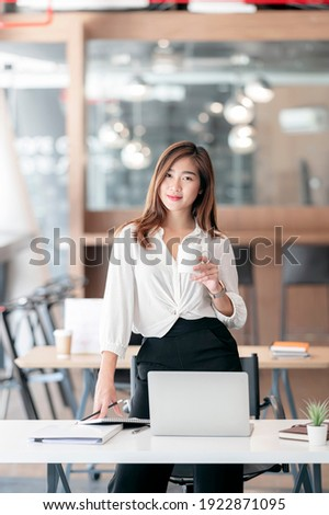portrait of relaxed businesswoman standing while holding pockets Stock photo © feedough