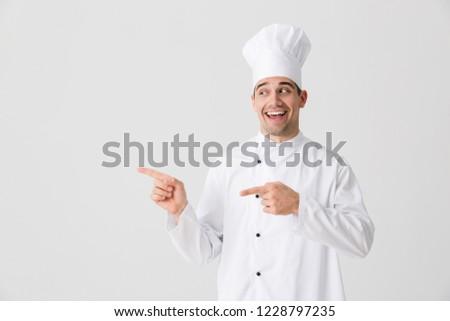 Izgatott fiatalember szakács bent izolált fehér Stock fotó © deandrobot