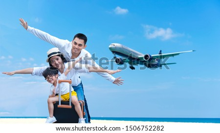 mother and son have fun on the beach watching the landing planes traveling on an airplane with chil stock photo © galitskaya