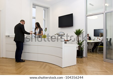 Manager in front of the office desk with communication concept Stock photo © ra2studio