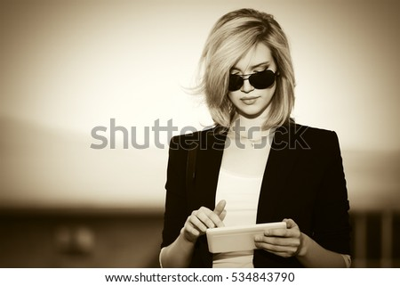 business woman posing outdoors at the street using laptop computer stock photo © deandrobot