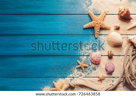 Summer time concept with sea shells on a blue wooden background  Stock photo © manaemedia