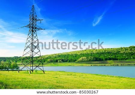 High Voltage Line And Electricity Pylon On Coastline Of River Stock photo © Serg64