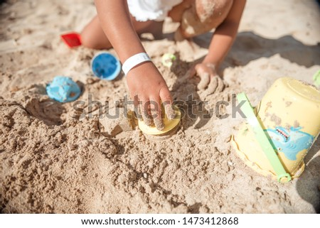 Toddler Girl Playing With Colorful Toys And Seashells On Sand stock photo © AndreyPopov