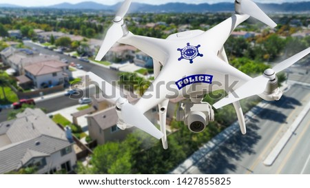 Police Unmanned Aircraft System, (UAS) Drone Flying Above A Neig Stock photo © feverpitch