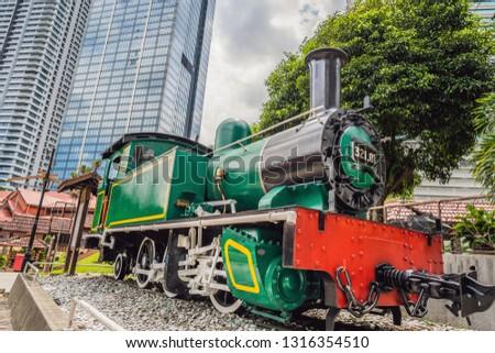 Klasszikus vonat felhőkarcolók Malajzia Kuala Lumpur utazás Stock fotó © galitskaya
