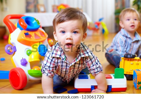 Stock photo: child toddler playing toys at home or kindergarten with mother
