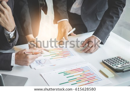 businessteam looking at financilal report and having a discussio Stock photo © Freedomz