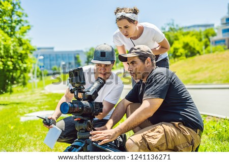 camera operator and director discuss the process of a commercial video shoot banner long format stock photo © galitskaya