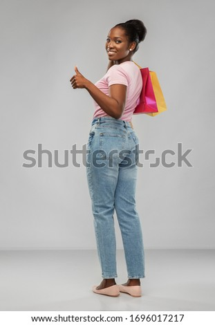 Happy young female shopaholic showing thumb-up gesture and plastic credit card Stock photo © pressmaster