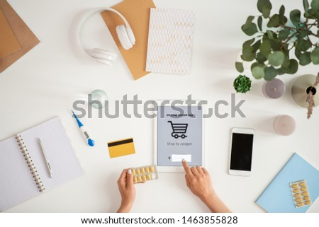 Sick customer with pills pointing at search line in touchscreen Stock photo © pressmaster