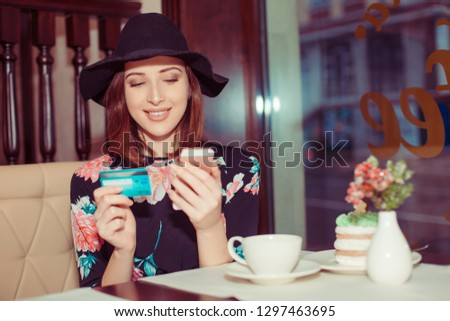 Young female buyer using credit card to pay for flowers in modern garden center Stock photo © pressmaster