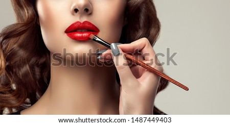 woman applying lipstick model painted red lips beauty face with perfect fresh skin stock photo © serdechny
