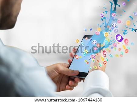 Homem telefone mãos aplicações ícones para cima Foto stock © wavebreak_media