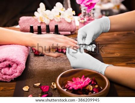 manikűr · eljárás · szépségszalon · profi · kezek · közelkép - stock fotó © galitskaya