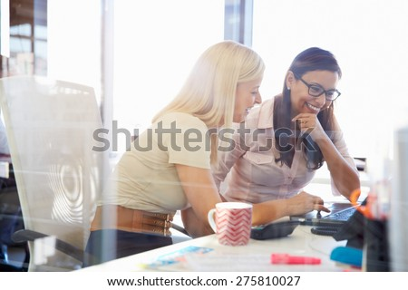 two business persons working at office desk and discussing using stock photo © freedomz