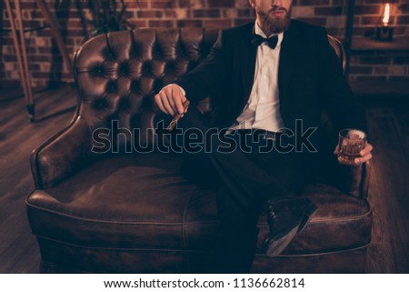 Serious man sitting on couch in luxurious restaurant and scrolling in smartphone Stock photo © pressmaster