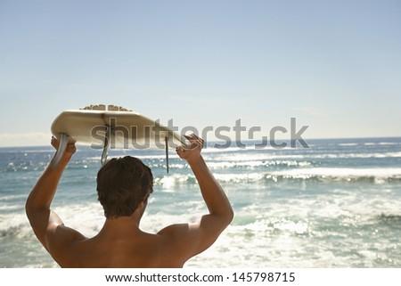 вид сзади рубашки молодые мужчины Surfer доска для серфинга Сток-фото © wavebreak_media
