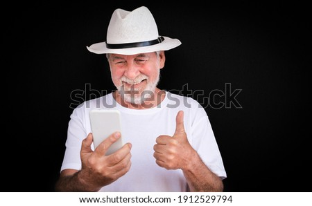 Front view of happy senior black man with hat looking at camera on beach in the sunshine Stock photo © wavebreak_media