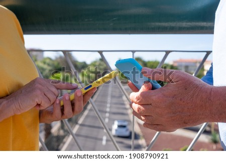 Mid section of senior couple holding hands and standing on beach in the sunshine Stock photo © wavebreak_media