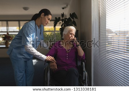 front view of female doctor consoling sad disable senior woman at nursing home stock photo © wavebreak_media