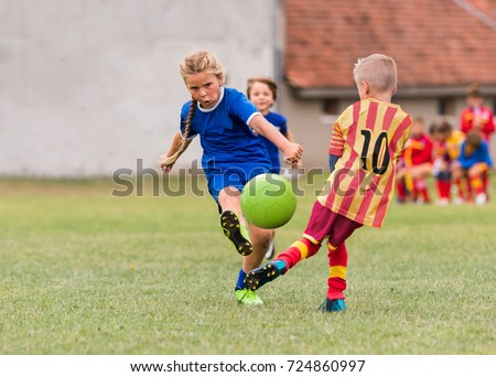 Active boys and girls playing sport and fun activities outside Stock photo © bluering