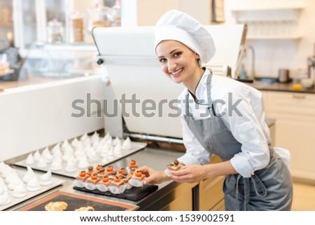 Paitssier putting petite fours on a sheet Stock photo © Kzenon