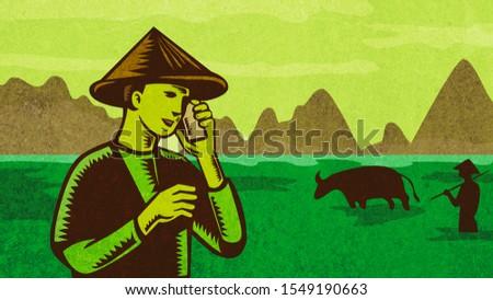 Vietnamese or South East Asian farmer talking on mobile phone Retro Stock photo © patrimonio