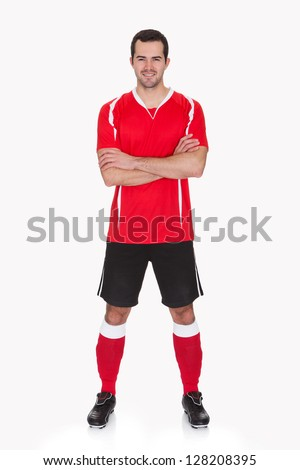 Confident handsome young football player in sports t-shirt standing in wall pose during soccer match Stock photo © benzoix