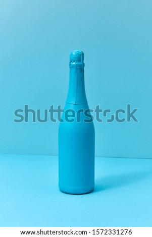 Holiday champagne mock up bottle painted blue with soft shadows. Stock photo © artjazz