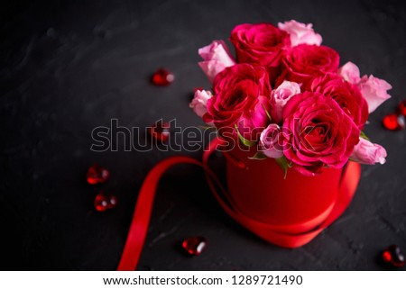 Pink roses bouquet packed in red box and placed on black stone background Stock photo © dash