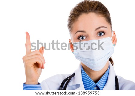 Doctor wearing a medical mask and pointing to it with her finger Stock photo © Margolana
