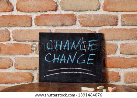 Black board with the phrase CHANCE CHANGE drown by hand on woode Stock photo © marylooo