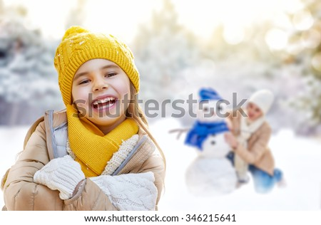 Mother and Kid Sculpting Snowman in Winter Park Stock photo © robuart