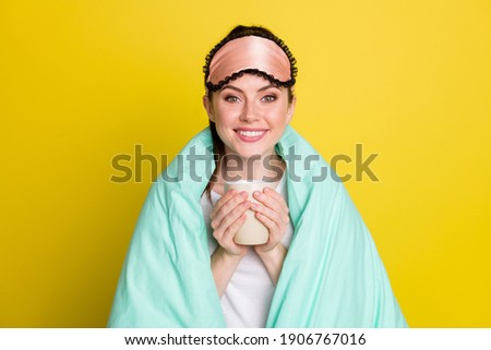 Attractive woman dressed in nightwear, holds white mug with coffee or tea, has morning drink, poses  Stock photo © vkstudio