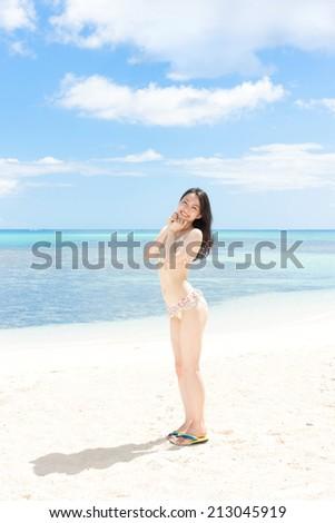Asian bikini model woman relaxing sunbathing on white sand on paradise beach tropical travel, blue o Stock photo © Maridav