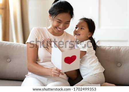 Small adorable female kid prepares surprise for her mother, clos Stock photo © vkstudio