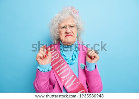 People, beauty and facial expressions concept. Discontent brunette cute woman pouts lips and frowns  Stock photo © vkstudio