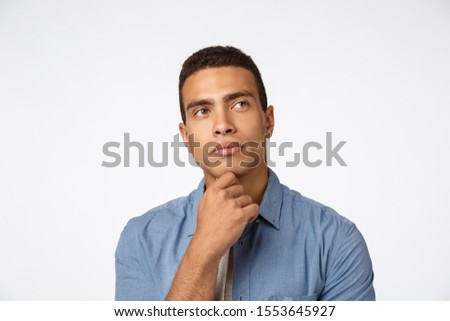 Close-up thoughtful brazilian man, rubbing chin and looking up, pondering idea, have some plan, thin Stock photo © benzoix
