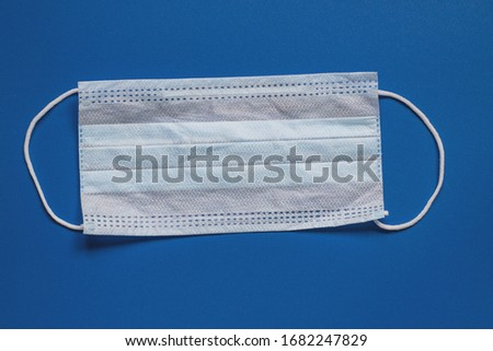 Face mask shield on blue background. Best protection from coronavirus, germs,bacteria and viruses.  Stock photo © DenisMArt