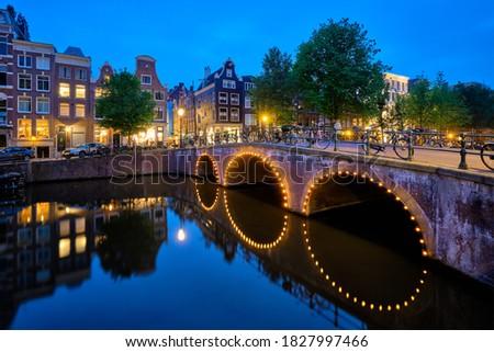 Canal ponte medieval casas noite noite Foto stock © dmitry_rukhlenko