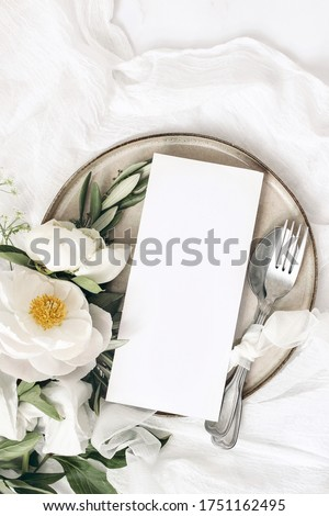 Dining plate and cutlery with peony flowers as wedding decor set on pink background, top tableware f Stock photo © Anneleven