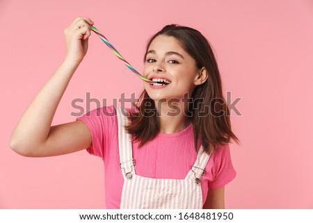 Foto ragazza sorridere mangiare multicolore Foto d'archivio © deandrobot