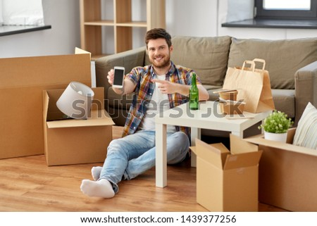 man with smartphone and takeaway food moving Stock photo © dolgachov