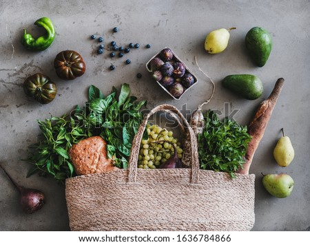 Fresh bread, avocado and tomatoes in a reusable bag on a stylish wooden kitchen surface. Zero waste  Stock photo © galitskaya