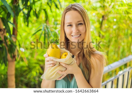 Mango in a reusable bag in female hands. Zero waste concept, plastic free concept. Healthy clean eat Stock photo © galitskaya