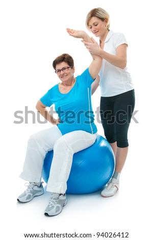 instructor assisting senior doing exercise working out in clinic Stock photo © snowing