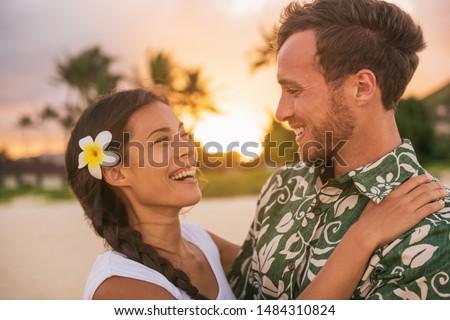 Couple in love on Hawaii travel vacation. Happy Asian woman piggybacking on Caucasian man, multicult Stock photo © Maridav