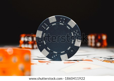 Stock photo: Blue dices on poker cards concepts of gambling or taking a risk